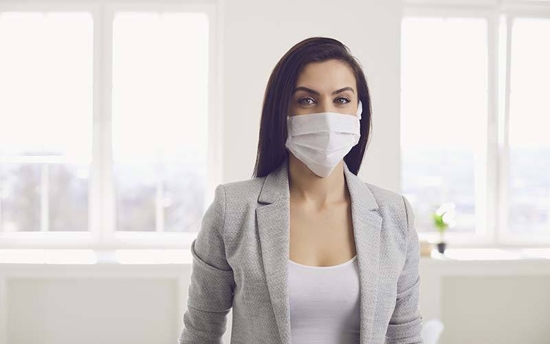 Danger Of Infection Of The Virus Coronavirus Infection. Businesswoman In Medical Mask At Office
